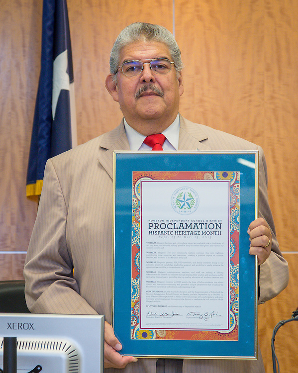 Houston ISD trustee Manuel Rodriguez presents a proclamation for Hispanic Heritage Month during a Board of Trustees meeting, September 10, 2015.