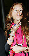 03.JUNE.2009. LONDON<br /> <br /> AMERICAN ACTRESS LINDSEY LOHAN LEAVING CRYSTAL CLUB, SOHO AT 1.00AM WITH A FRIEND AND HEADED ONTO BUNGALO 8 CLUB WHERE HER ON OFF GIRLFRIEND SAM RONSON WAS PARTYING WITH HER BROTHER MARK AND HIS GIRLFRIEND TENNESSE THOMAS. SAM AND MARK THEN LEFT AT 1.45AM AND HEADED BACK TO SAM'S HOTEL MEANWHILE LINDSEY LEFT BUNGALO 10 MINUTES AFTER SAM AND THEY ENDED BACK AT SAM'S HOTEL AT THE SAME TIME ANS SAM GOT OUT AND WALKED PAST LINDSEY'S CAR WITH LINDEY SCREAMING AT THE DRIVER TO STOP AND IT LOOKED LIKE SHE HAD BEEN CRYING BEFORE GOING INTO THE HOTEL.<br /> <br /> BYLINE: EDBIMAGEARCHIVE.COM<br /> <br /> *THIS IMAGE IS STRICTLY FOR UK NEWSPAPERS AND MAGAZINES ONLY*<br /> *FOR WORLD WIDE SALES AND WEB USE PLEASE CONTACT EDBIMAGEARCHIVE - 0208 954 5968*