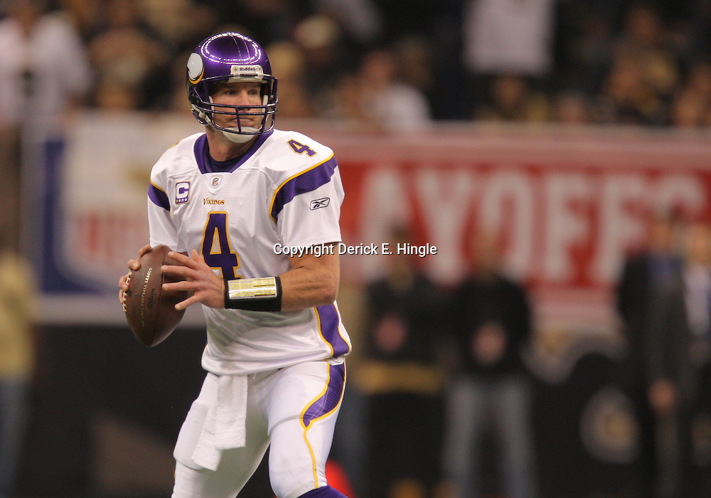Jan 24, 2010; New Orleans, LA, USA; Minnesota Vikings quarterback Brett Favre (4) looks to pass during a 31-28 overtime victory by the New Orleans Saints over the Minnesota Vikings in the 2010 NFC Championship game at the Louisiana Superdome. Mandatory Credit: Derick E. Hingle-US PRESSWIRE.