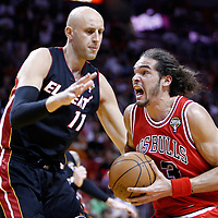 06 March 2010: Chicago Bulls center Joakim Noah (13) drives past Miami Heat center Zydrunas Ilgauskas (11) during the Chicago Bulls 87-86 victory over the Miami Heat at the AmericanAirlines Arena, Miami, Florida, USA.