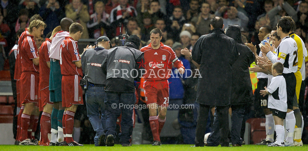 LIVERPOOL, ENGLAND - Tuesday, January 15, 2008: Liverpool's Jamie Carragher walks out to a guard of honour from Liverpool and Luton Town players as he makes his 500th appearance during the FA Cup 3rd Round Replay at Anfield. (Photo by David Rawcliffe/Propaganda)