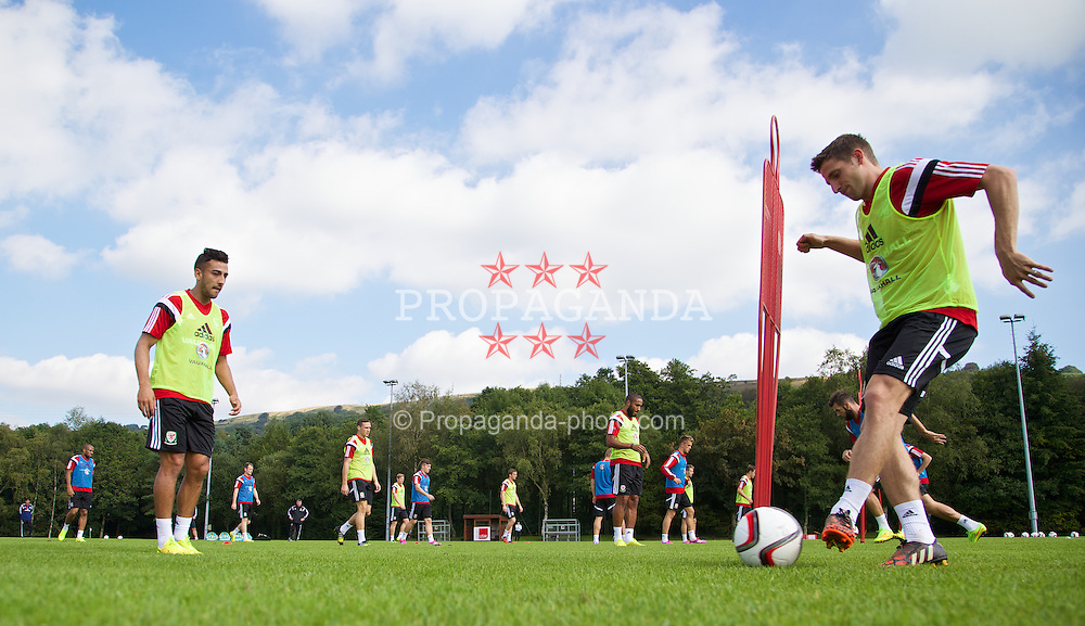 CARDIFF, WALES - Sunday, September 7, 2014: Wales' Joe Allen training at the University of South Wales Sport Park ahead of the opening UEFA Euro 2016 qualifying match against Andorra. (Pic by David Rawcliffe/Propaganda)