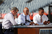 Football analysts (L-R) Dan Patrick, Tony Dungy, and Rodney Harrison get set to go on the air before the Denver Broncos 2016 NFL week 1 regular season football game against the Carolina Panthers on Thursday, Sept. 8, 2016 in Denver. The Broncos won the game 21-20. (©Paul Anthony Spinelli)