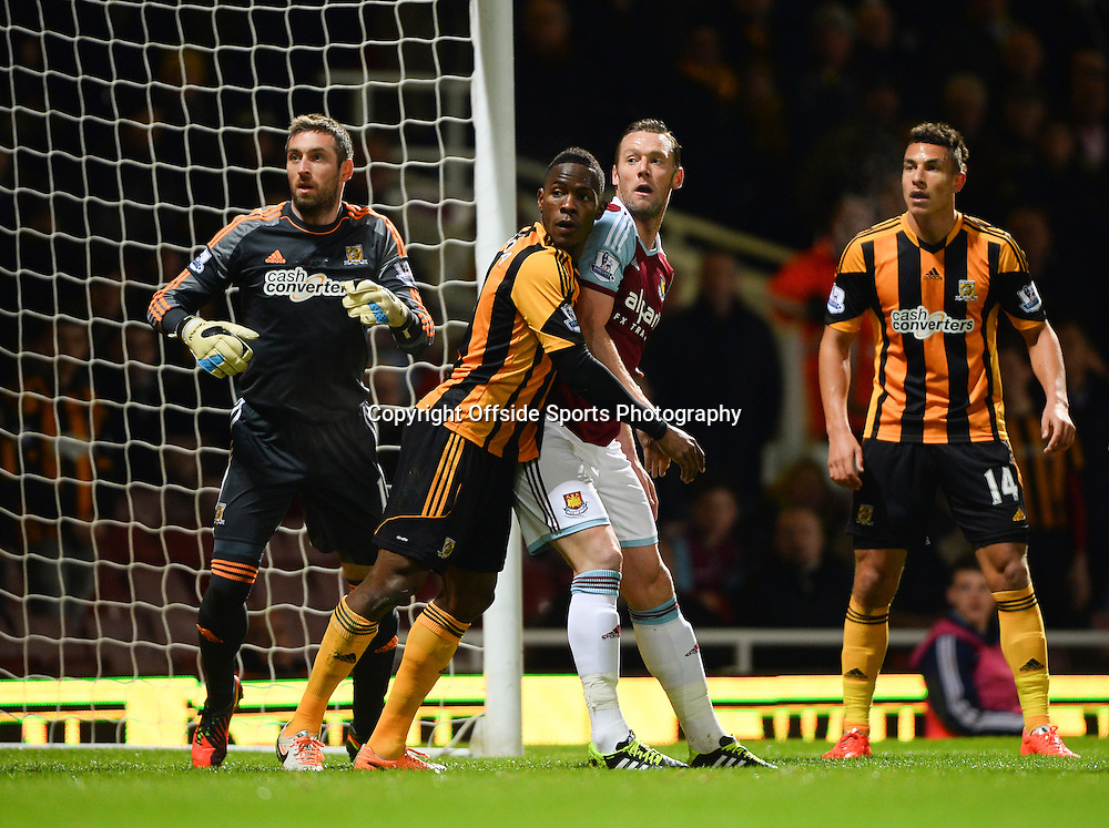 26 March 2014 - Barclays Premier League - West Ham United v Hull City - Maynor Figueroa of Hull City leans on Kevin Nolan of West Ham United as they await a corner kick - Photo: Marc Atkins / Offside.