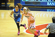 "Mississippi Lady Rebels guard Gracie Frizzell (12) drives against Kentucky Wildcats guard Jennifer O'Neill (0) at the C.M. ""Tad"" Smith Coliseum in Oxford, Miss. on Monday, February 23, 2015. (AP Photo/Oxford Eagle, Bruce Newman)"