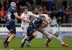 Exeter Chiefs' Ian Whitten (left) and Don Armand (right) tackle Sale Sharks' Faf De Klerk during the Gallagher Premiership match at the AJ Bell Stadium, Salford.