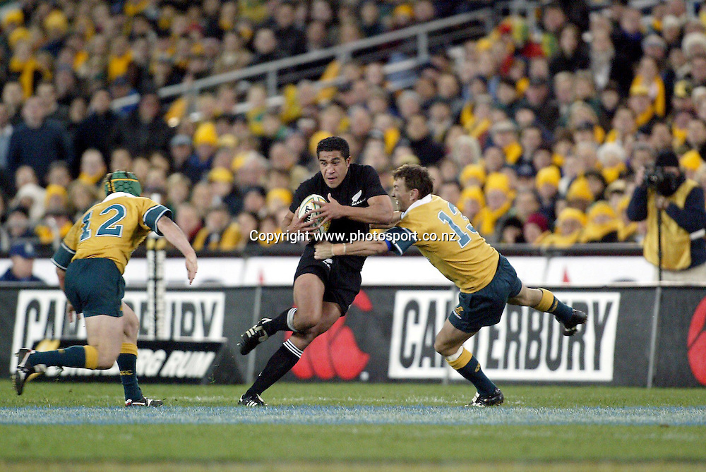 Mils Muliaina in action during the Bledisloe Cup international rugby match between the New Zealand All Blacks and Australia at Telstra Stadium, Sydney, Australia on 26 July, 2003. The All Blacks won the match, 50 -21. Photo: Andrew Cornaga/PHOTOSPORT<br />