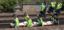 © Licensed to London News Pictures. 18/06/2018. London, UK. Police carry bodies away from the train tracks near Loughborough Junction station after three bodies were discovered after they were reportedly hit by a train. Photo credit: Rob Pinney/LNP