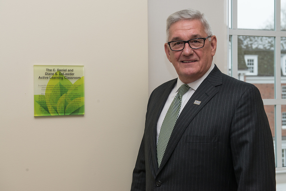 Daniel DeLawder,  stands beside his plaque inside the new Active Learning Center on the third floor of the newly renovated McCracken Hall on January 27, 2017.