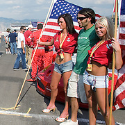 Flag girls show of the colors of their teams prior to the start of the Utah Grand Prix Le Mans Race at the Larry H. Miller Motor Sports Park in Tooele, Utah July. 15, 2006. August Miller