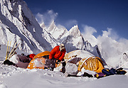 Digging out tents, under Mitre peak, near Concordia, winter ski expedition up Baltoro glacier, Karakoram, Pakistan