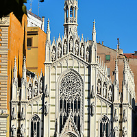Chiesa del Sacro Cuore del Suffragio in Rome, Italy<br /> The Church of the Sacred Heart of the Suffrage is often called the Little Milan Cathedral thanks to its similar neo-gothic design. Surrounding its slender bell tower are six elegant spires. The fa&ccedil;ade is also graced with nineteen statues of saints. This Roman Catholic church was built in 1917 on the west bank of the Tiber River. Inside you&rsquo;ll also find the small Museum of the Souls of Purgatory.