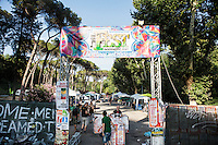 "ROME, ITALY - 3 JULY 2016: The entrance to the iFest, an alternative music festival where the Gipsy Queens have their food stand, is seen here  in Rome, Italy, on July 3rd 2016.<br /> <br /> The Gipsy Queens are a travelling catering business founded by Roma women in Rome.<br /> <br /> In 2015 Arci Solidarietà, an independent association for the promotion of social development, launched the ""Tavolo delle donne rom"" (Round table of Roma women) to both incentivise the process of integration of Roma in the city of Rome and to strengthen the Roma women's self-esteem in the context of a culture tied to patriarchal models. The ""Gipsy Queens"" project was founded by ten Roma women in July 2015 after an event organised together with Arci Solidarietà in the Candoni Roma camp in the Magliana, a neighbourhood in the South-West periphery of Rome, during which people were invited to dance and eat Roma cuisine. The goal of the Gipsy Queen travelling catering business is to support equal opportunities and female entrepreneurship among Roma women, who are often relegated to the roles of wives and mothers."