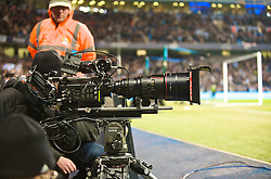 MANCHESTER, ENGLAND - Tuesday, January 19, 2010: A television cameraman using a Red camera to cover the Mancunian derby during the Football League Cup Semi-Final 1st Leg at the City of Manchester Stadium. (Photo by David Rawcliffe/Propaganda)