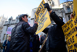 © Licensed to London News Pictures. 05/12/2016. London, UK. A Pro Brexit supporter (left wearing cap) confronts anti Brexit demonstrators outside the Supreme Court  in Westminster, London on the first day of a  Supreme Court hearing to appeal against a November 3 High Court ruling that Article 50 cannot be triggered without a vote in Parliament. Photo credit: Ben Cawthra/LNP
