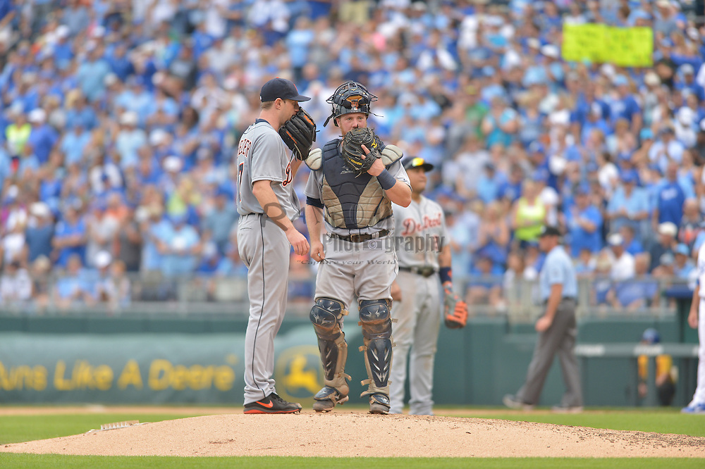 Sep 20, 2014; Kansas City, MO, USA; Detroit Tigers catcher Bryan Holaday (50) visits with starting pitcher Max Scherzer (37) on the mound in the sixth inning against the Kansas City Royals at Kauffman Stadium. Detroit won 3-2. Mandatory Credit: Denny Medley-USA TODAY Sports