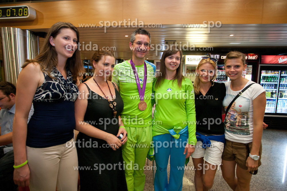 Rajmond Debevec and Ziva Dvorsak during reception of Slovenian Olympic team, on August 7, 2012 in Airport Joze Pucnik, Brnik, Slovenia.  (Photo by Matic Klansek Velej / Sportida)