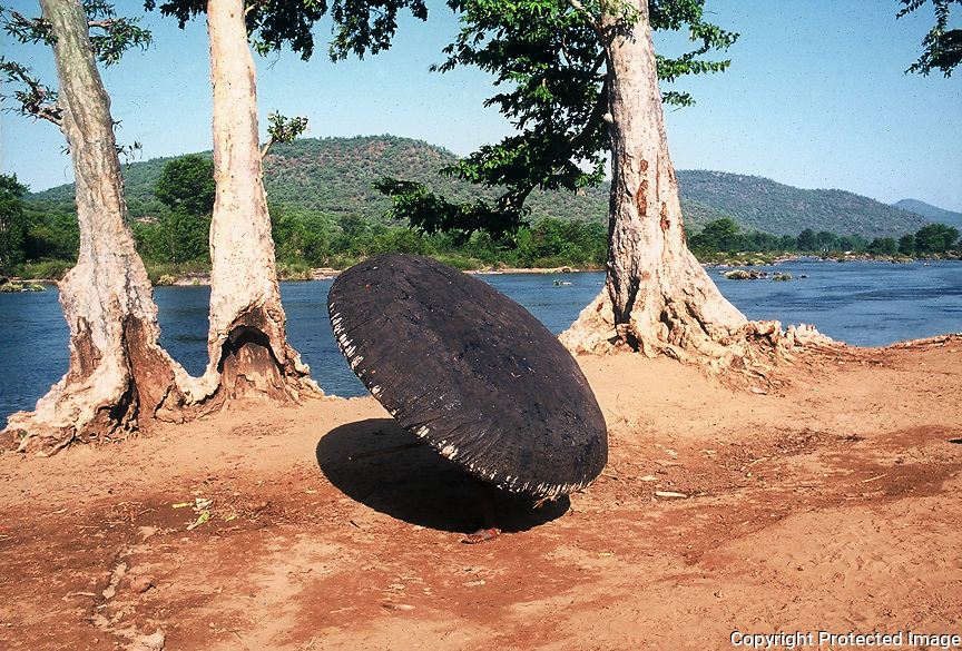 A villager carrying the 'Coracle' on the banks of the River Cauvery,Hogenakkal,Tamilnadu,india. Coracles are primitive, light, bowl-shaped boats with a frame of woven grasses, reeds, or saplings covered with hides.Indian coracles are considered to have been in existence since prehistoric times,and are a major tourist attraction at the Hogenakkal falls on the Kaveri river Although these boats were originally designed for general transport, they have recently been used mostly for giving tourists rides.