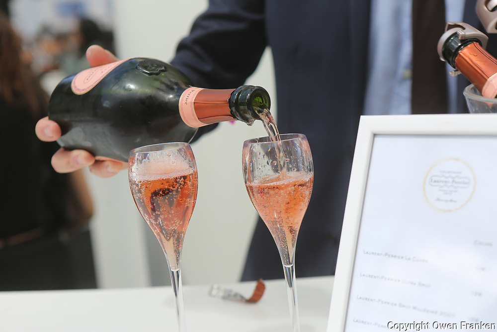 pouring rosé Champagne at the food fair, Taste of Paris