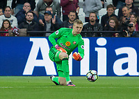 Football - 2016 / 2017 Premier League - West Ham United vs. Sunderland<br /> <br /> Jordan Pickford of Sunderland rolls the ball out at The London Stadium.<br /> <br /> COLORSPORT/DANIEL BEARHAM
