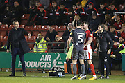 Trouble flares between 7 Chris Porter for Crewe Alexander and #5 Jason Shackell for Lincoln City during the EFL Sky Bet League 2 match between Crewe Alexandra and Lincoln City at Alexandra Stadium, Crewe, England on 26 December 2018.
