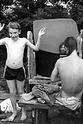 Men and boys at the hot tubs, Glastonbury, Somerset, 1989
