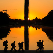 Soldiers based at one of the many military bases in the Washington DC area do early morning training around the Lincoln Memorial and Reflecting Pool in Washington DC.