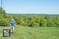 Half marathon and 5k running races at the 2014 Marquette Trails Festival at Marquette Mountain Ski Area in Marquette, Michigan.  The event showcases the trails of the Noquemanon Trail Network.