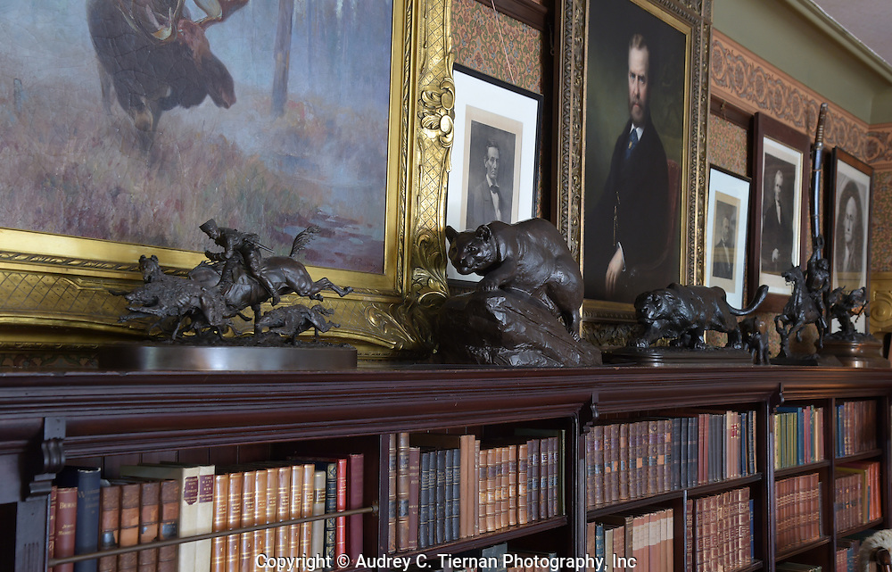 """Oyster Bay, NY,  September 14, 2015: ---   Sagamore Hill was the home of the 26th president of the United States, Theodore Roosevelt. The home recently underwent a ten million dollar renovation. This is a vignette of some of the bronze pieces in Theodore Roosevelt's library. TR's younger daughter, Ethel, described the Library as """"the heart of the home."""" The room doubled as TR's study and a family gathering place. In the evenings, TR and Edith would sit in front of the fire, write letters, and read aloud to each other and to the children. © Audrey C. Tiernan"""