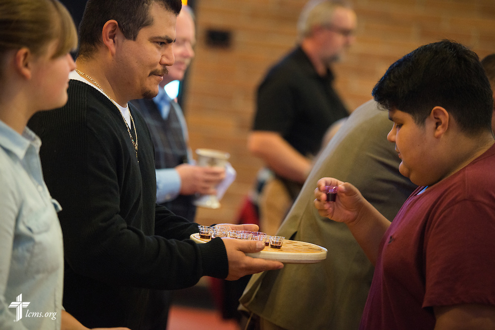 Church members receive communion during a monthly bilingual worship on Sunday, Nov. 22, 2015, at Salem Lutheran Church in Springdale, Ark. LCMS Communications/Erik M. Lunsford
