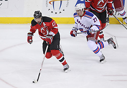 May 19, 2012; Newark, NJ, USA; New Jersey Devils left wing Ilya Kovalchuk (17) skates with the puck while being chased by New York Rangers defenseman Ryan McDonagh (27) during the first period in game three of the 2012 Eastern Conference Finals at the Prudential Center.