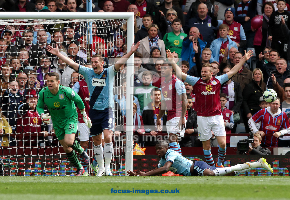 Kevin Nolan (2nd left) of West Ham United appeals for a penalty after his team mate Enner Valencia (bottom right) goes down in the box during the Barclays Premier League match at Villa Park, Birmingham<br /> Picture by Tom Smith/Focus Images Ltd 07545141164<br /> 09/05/2015