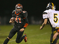 Springville's Drake Coonrod (41) eyes Midland's Ben Carstensen (5) on a run during their game at Allison Field in Springville on Friday October 19, 2012. Midland defeated Springville 30-29.