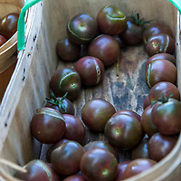 A basket of  'Chocolate Cherry' heirloom tomatoes