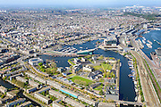 Nederland, Noord-Holland, Amsterdam, 09-04-2014;<br /> Overzicht Marineterrein (midden) en omgeving, onderin Kattenburg met de klok mee: Scheepvaartmuseum, centrum Amsterdam,  Westerpark en Westerdok,  Centraal station, midden museum Nemo, IJtunnel en Oosterdokseiland, <br /> View Navy area (center) and the National Maritime Museum (white building), old town Amsterdam, Museum Nemo, top right central station. <br /> luchtfoto (toeslag op standard tarieven);<br /> aerial photo (additional fee required);<br /> copyright foto/photo Siebe Swart