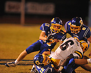 Oxford High's Ethan Holmes (12), Oxford High's Conrey Meagher(17), and Oxford High's Franklin Tatum (8)  make a tackle vs. Hernando in Oxford, Miss. on Friday, October 14, 2011. Hernando won 31-30 in overtime.