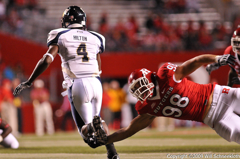 Sep 19, 2009; Piscataway, NJ, USA; Florida International wide receiver T.Y. Hilton (4) runs past a diving Rutgers defensive end Evan Lampert (98) during the second half of Rutgers' 23-15 victory over Florida International at Rutgers Stadium.