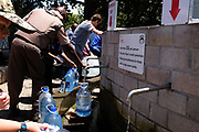 People collect water at Josephine's Mill Spring, Newlands. Water is collected tp offset the 50l a day limit for household use and to offset the cost of municipal water. January 2018.
