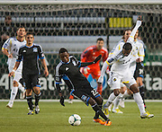 San Jose Earthquakes Abu Tommy (22 Black) outsteps an AIK defender in MLS preseason tournament action at Portland, Oregon's Jeld Wen Field against Sweden's AIK. The game ended in a 0-0 draw.