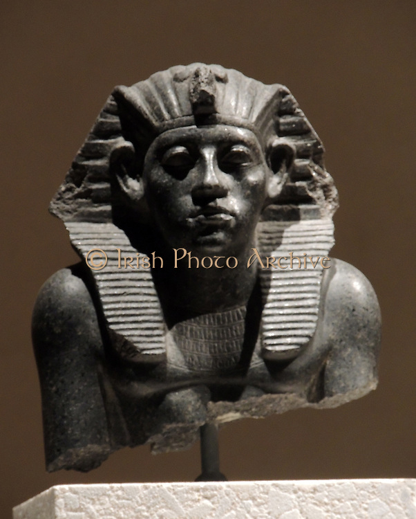 Head of a statue of King Amenemhet 111with king's head-cloth,12th Dynasty about 1840