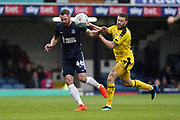 John White of Southend United passes under pressure from Jamie Mackie of Oxford United during the EFL Sky Bet League 1 match between Southend United and Oxford United at Roots Hall, Southend, England on 6 October 2018.