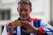 London, 10th September 2012. Paralympian Richard Whitehead the Men's 200m T42 medallist shows off his gold medal the day after the end of the London 2012 Paralympics as thousands of spectators lined the capital's streets to honour 800 of TeamGB's athletes and Paralympians. Britain's golden generation of athletes in turn said thank you to its Olympic followers, paying tribute to London and a wider Britain as up to a million people lined the streets to celebrate the ?greatest ever? sporting summer and billed to be the biggest sporting celebration ever seen in the UK.