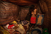 A 17 years old prostitute finishes to wear nice clothes before a long night in the red lights district. In the capital city, Addis Ababa, the number of girls under 18 years old victimised in commercial sexual exploitation is increasing at an alarming rate.<br /> <br /> Addis Ababa, Ethiopia, 21-12-2012.<br /> <br /> To protect the identities of the recorded subjects names are omitted