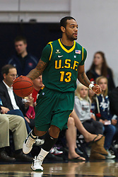 Jan 9, 2012; Moraga CA, USA;  San Francisco Dons guard Rashad Green (13) dribbles the ball against the St. Mary's Gaels during the first half at McKeon Pavilion.  St. Mary's defeated San Francisco 87-72. Mandatory Credit: Jason O. Watson-US PRESSWIRE