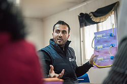 20 February 2020, Za'atari Camp, Jordan: Incentive-Based Volunteer Mefleh Faouri shows an innovative water filtering system built by recycling used plastic bottles, as he leads a session in the 'Innovation Lab' in the Peace Oasis, a Lutheran World Federation space in the Za'atari Camp where Syrian refugees are offered a variety of activities on psychosocial support, including counselling, life skills trainings and other activities. The innovation lab sets out to give youth a space to work on creative solutions to help improve life in the camp, while also stimulating creative thinking.