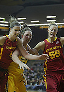 December 09 2010: Iowa St. forward Hallie Christofferson (5), Iowa center Morgan Johnson (12), and Iowa St. center Anna Prins (55) battle for a ball during the first half of their NCAA basketball game at Carver-Hawkeye Arena in Iowa City, Iowa on December 9, 2010. Iowa defeated Iowa State 62-40 in the Hy-Vee Cy-Hawk Series rivalry game.