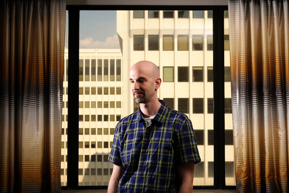 Photo by Matt Roth<br /> Assignment ID: 30146741A<br /> <br /> Photographer Matthew Schrier escaped from a Syrian terrorist prison. Since his return to the US, he has been feeding intelligence to counter-terrorism officials. He is photographed in his hotel room at the Hilton Crystal City in Arlington, Virginia Tuesday, August 20, 2013.