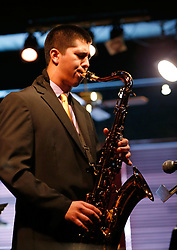 BrandonLee Cierley on the saxophone with the PLU Jazz Ensemble at Tula's Jazz Club in Seattle on Sunday, May 3, 2015. (Photo: John Froschauer/PLU)