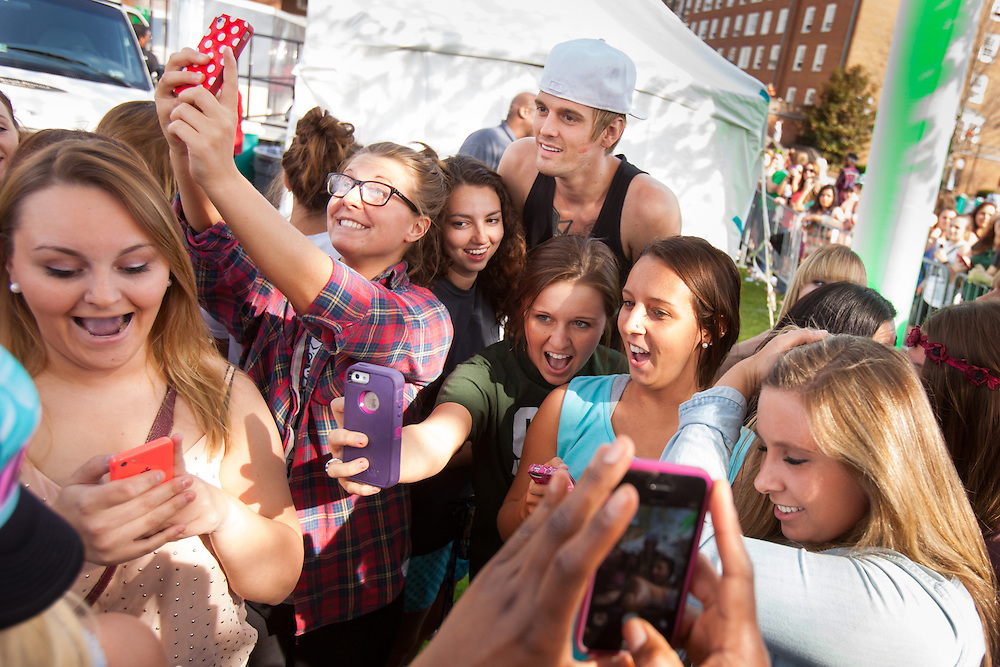 Performer Aaron Carter poses for photos with his fans before the start of his concert at Ohio University on April 24, 2014.  Photo by Ohio University / Jonathan Adams
