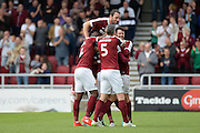 The Northampton Town players celebrate Northampton Town midfielder Matt Taylor (31) goal (3-0)during the EFL Sky Bet League 1 match between Northampton Town and Southend United at Sixfields Stadium, Northampton, England on 24 September 2016. Photo by Dennis Goodwin.